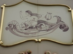 Mermaid on side of Steam Carousel